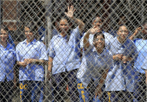 Mothers watch their children arrive to visit at California Institute for Women state prison in Chino, California May 5, 2012. An annual Mother's Day event, Get On The Bus, brings children in California to visit their mothers in prison. Sixty percent of parents in state prison report being held over 100 miles (161 km) from their children. Picture taken May 5, 2012 REUTERS/Lucy Nicholson (UNITED STATES - Tags: CRIME LAW SOCIETY) ATTENTION EDITORS PICTURE 01 OF 28 FOR PACKAGE 'MOTHER'S DAY BEHIND BARS'